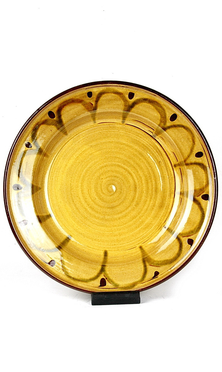 Clive Bowen earthenware charger, yellow glaze base with green arching motif around rim and brown spot to the top between each arch