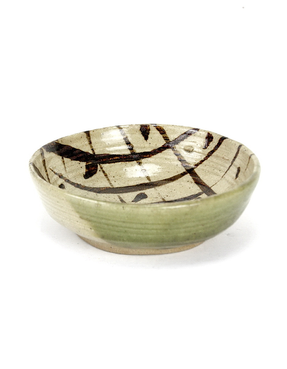 Janet Leach stoneware bowl with oatmeal glaze, blush of green glaze to one part of exterior. Interior bowl decorated by brushwork criss cross lines and dots