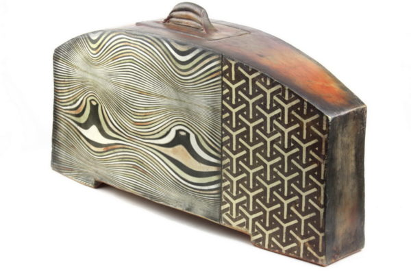 John Bedding large rectangular arched illustrated vessel with lid to top of arch. One section with undulating wave pattern and second section with geometric interlocking cube pattern