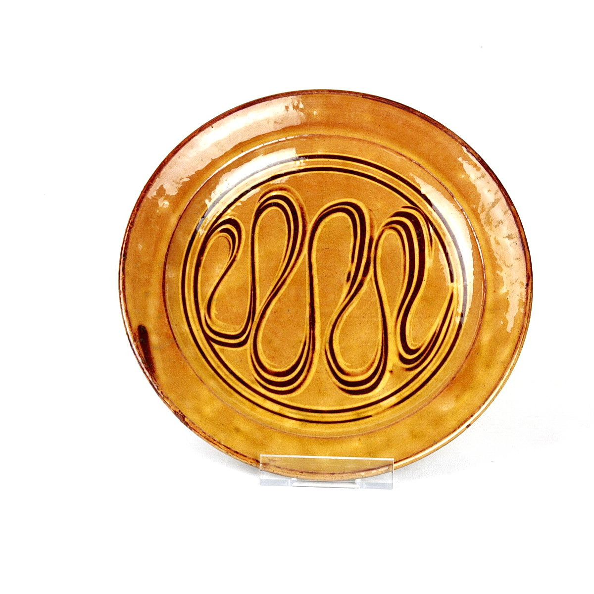 Michael Cardew earthenware slipware dish. Yellow glaze with wavy sgrafitto pattern to well