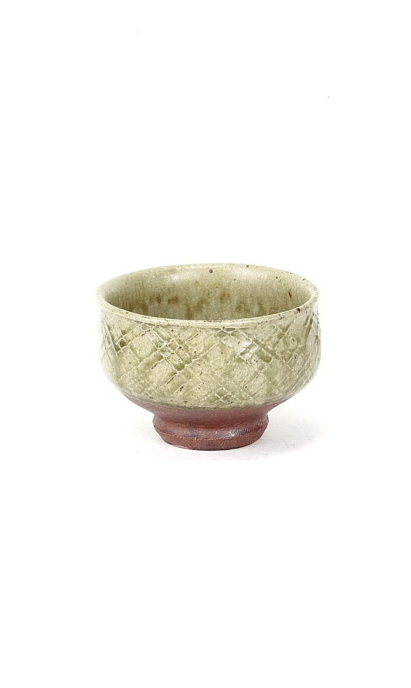 Phil Rogers footed stoneware chawan/teabowl with ash glaze and impressed criss cross pattern
