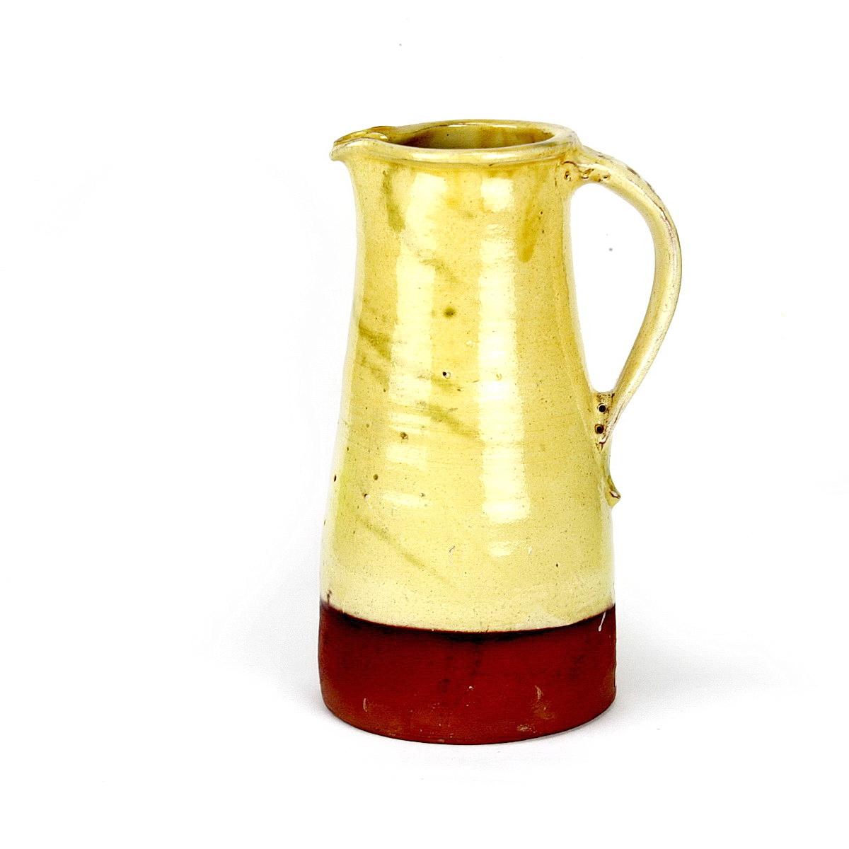 William Marshall large earthenware jug with yellow glaze to 3/4 of jug Base unglazed